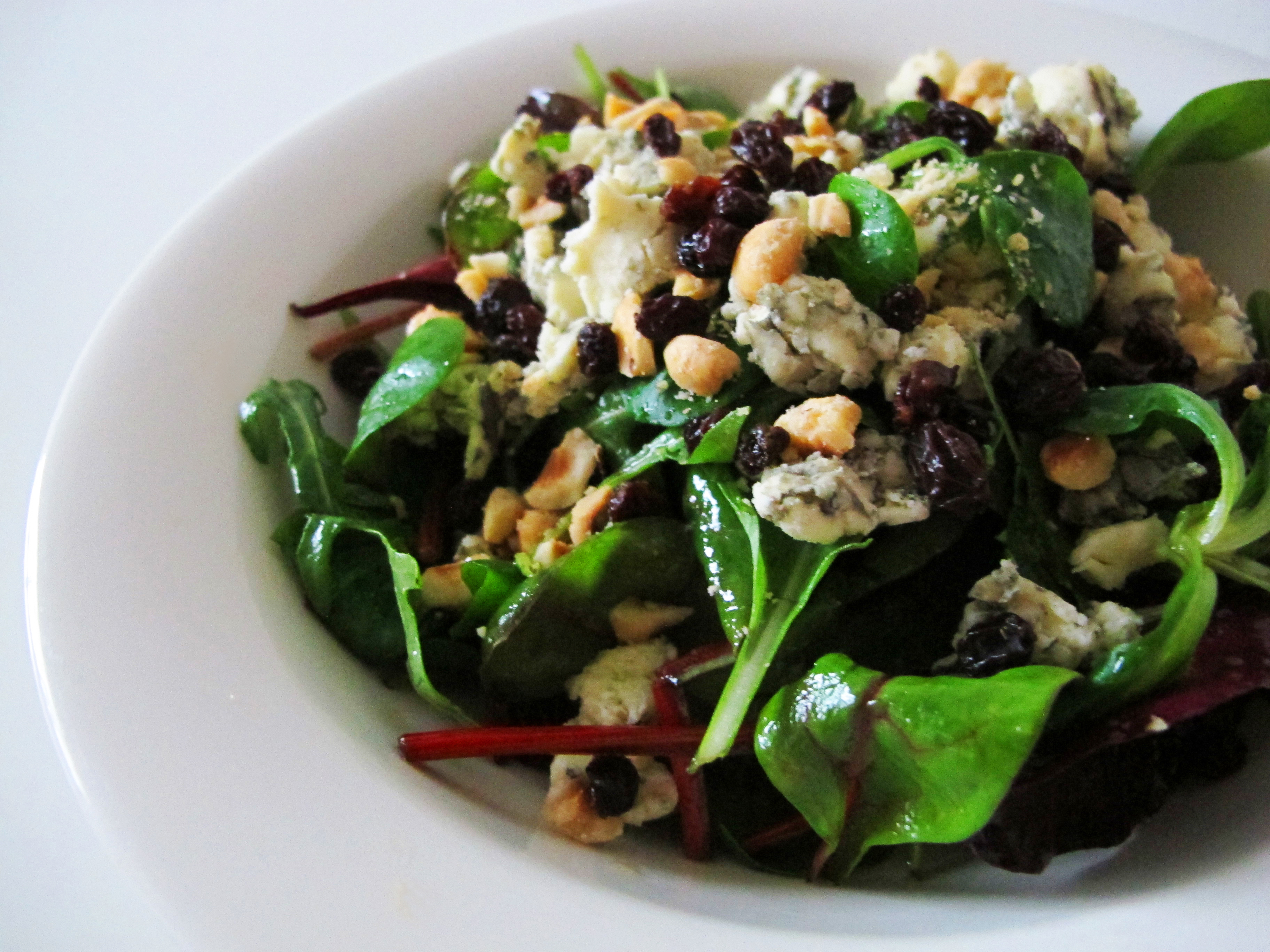 Mixed greens with blue cheese, currants, toasted hazelnuts, and honey ...